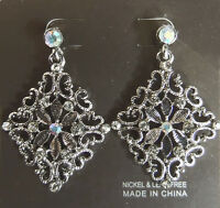 SILVER DIAMOND SHAPED FASHION EARRINGS WITH FLOWER IN CENTRE.