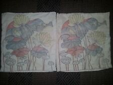 pair of quilted cushion covers