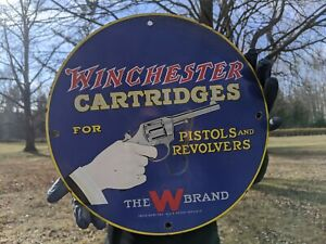 VINTAGE DATED 1957 WINCHESTER CARTRIDGES PORCELAIN SIGN PISTOLS AND REVOLVERS