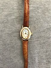 Cherokee Mother of Pearl Dial Gold Tone Case Ladies Quartz Watch
