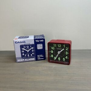 Casio TQ140-4DF White Dial Easy Reader Red Table Top Travel Alarm Clock