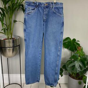 Vintage Levi's 511 Medium Wash Jeans Tapered Leg 33/30