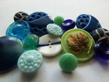 15 old/vintage glass buttons in a mix of blue and green