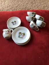 Antique Porcelain Children's Tea Set. Boy and Girl  with Flowers Made in Japan.