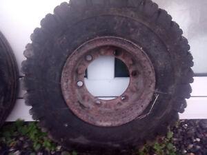 Fork lift steel rim with slick tyre and burst innr tube.