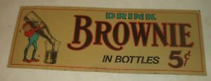ORIGINAL VINTAGE REPRODUCTION ? THIN TIN DRINK BROWNIE IN BOTTLES EMBOSSED SIGN