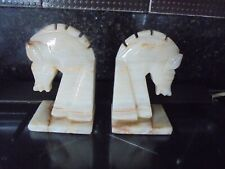 A PAIR OF ONYX HORSE HEAD BOOKENDS IN GOOD CLEAN CONDITION