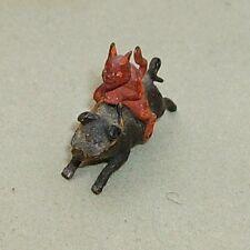 Antique miniature cold painted bronze devil riding pig