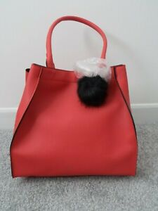 GORGEOUS RED FAUX LEATHER BUCKET BAG WITH BLACK FURRY FLUFFY POMPOM CHARM