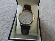 New Men's Q&Q Quartz Water Resistant Watch with a Brown Band