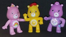 Lot Of 3 small Poseable Care Bears Figues Purple, Pink and Yellow Read descrip.