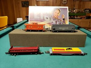 LOT OF AMERICAN FLYER FREIGHT CARS AND CABOOSE