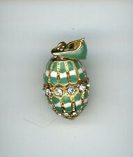 Russian Faberge Egg Pendant lt. Green enamelled finish and elongated gems, more.
