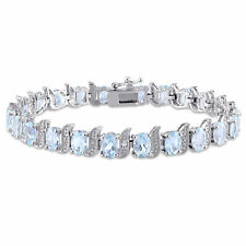 Amour Sterling Silver Blue Topaz and Diamond Accent Tennis Bracelet
