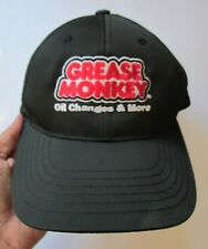 ad15a44c932 GREASE MONKEY SERVICE OIL CHANGES LOGO BLACK RED WHITE ADJ. HAT CAP