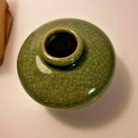 Vintage small vase dark green w/ crackle smooth glaze  3 in high x 4 1/2 in high