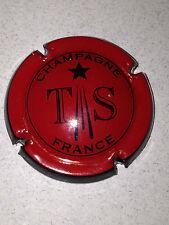 Capsule de champagne TRIBAUT (19. rouge contour noir)