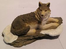 """Wolf / Wolves Figurine ,Wolf Laying On Snow Covered Ledge , Resin, 5 1/2"""" Long"""