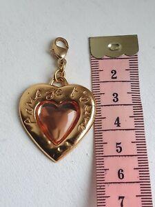Pendentif coeur rose  -- Yves Saint Laurent --  vintage