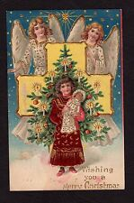 Christmas Postcard 1906 angels watching over girl holding Madonna (?) doll