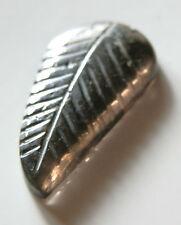 Carved leaf pattern tourmaline gem...7 carat