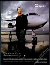 2008 Tiger Woods photo with his Gulfstream 450 plane Netjets vintage print ad