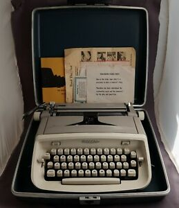 Vintage US made Royal Safari typewriter with script font - in case & all papers