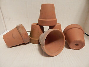 FOUR VINTAGE SMALL USED CLAY POTS