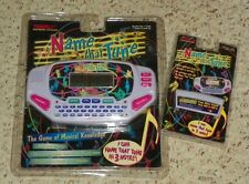 1997 Name That Tune - Electronic Hand Held Game by Tiger Electronics