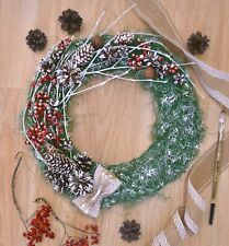 Christmas wreath, wreath on the front door, wreath with branches and cones
