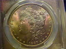 Rainbow Colors: Magenta with Blue, Green, & Gold 1887 Morgan Dollar PCGS MS63