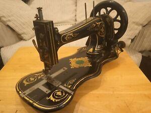 Antique Jones fiddle base medium sewing Machine