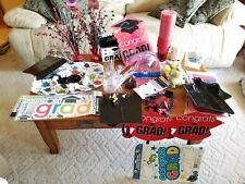 HUGE lot of graduation party supplies . Many new in package.