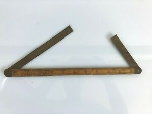 Vintage wooden ruler.  Unbranded, but unusual.  See Photos