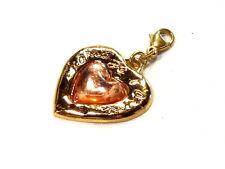 Bijou alliage doré pendentif coeur lucite bijou de sac créateur Yves St Laurent