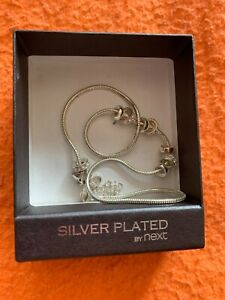 LADIES FEMALE WOMEN'S SILVER PLATED RINGED DESIGNED NECKLESS BY NEXT IN BOX.