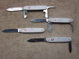 4 SWISS ARMY ALOX FOLDING KNIVES--4, 3, 2, &1 BLADES--2 ARE VG COND, 2 HAVE HOLE