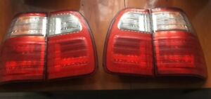 Lexus lx470 tail lights left and right sides all.