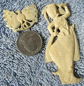 TWO ANITQUE BURMESE CARVED RESIN BAKELITE SCULPTURES BROOCHES PENDANTS