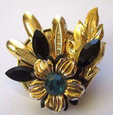 broche bijou couleur or navettes noires et pierre diamant bleu en résine 4460