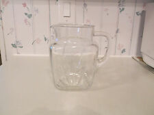 Vintage clear glass pitcher w/star on bottom, holds 48 ounces