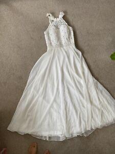 white wedding dress size 10 (has lace up at the back adjustable) Short Sleeve