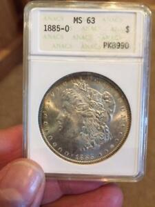 1885-O Morgan Dollar MS-63 NGC (Beautiful Obv & Rev Toning)