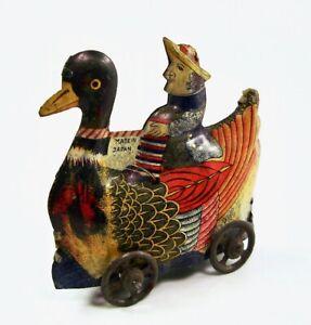 Pre War Dutch Missionary Riding Mandarin Duck Japanese Tin Penny Toy NR