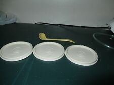 vintage tupperware-lot of 4 items-3 seals with the seal on it and 1 small ladel
