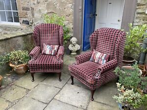 Two twentieth century wing back armchairs in plum flecked geometric upholstery