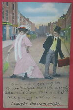 ANTIQUE I CAUGHT THE TRAIN ALRIGHT POSTCARD-MAN/WOMAN/OLD TIME STREET VIEW