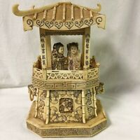 Antique Bone Asian Pagoda with a couple figurines.