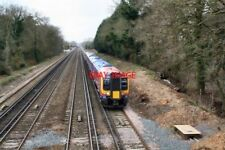 PHOTO  2007 DESIRO MULTIPLE-UNIT SET 450 098 IS SEEN ABOUT TO PASS UNDER THE OLD