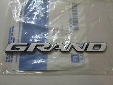 1996-2002 PONTIAC GRAND AM DRIVER OR PASSENGER SIDE WHITE GRAND EMBLEM 22636894